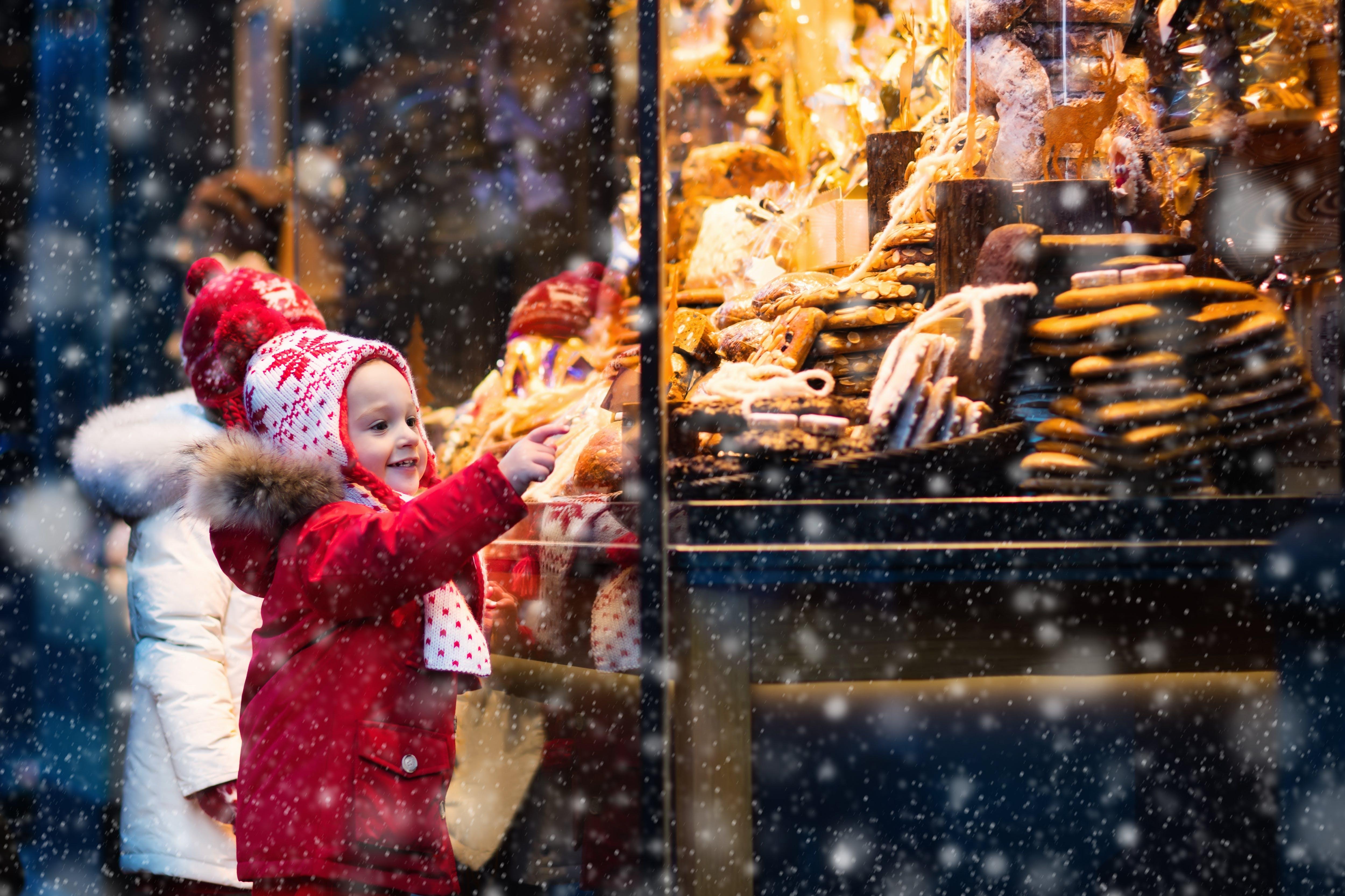 Little girl enjoying a Christmas Market