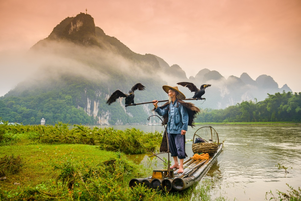 Fisherman works on the river near Yangshuo, China.