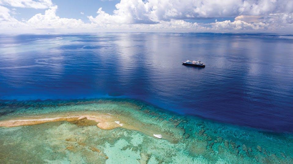 Silversea Silver Discoverer near a reef
