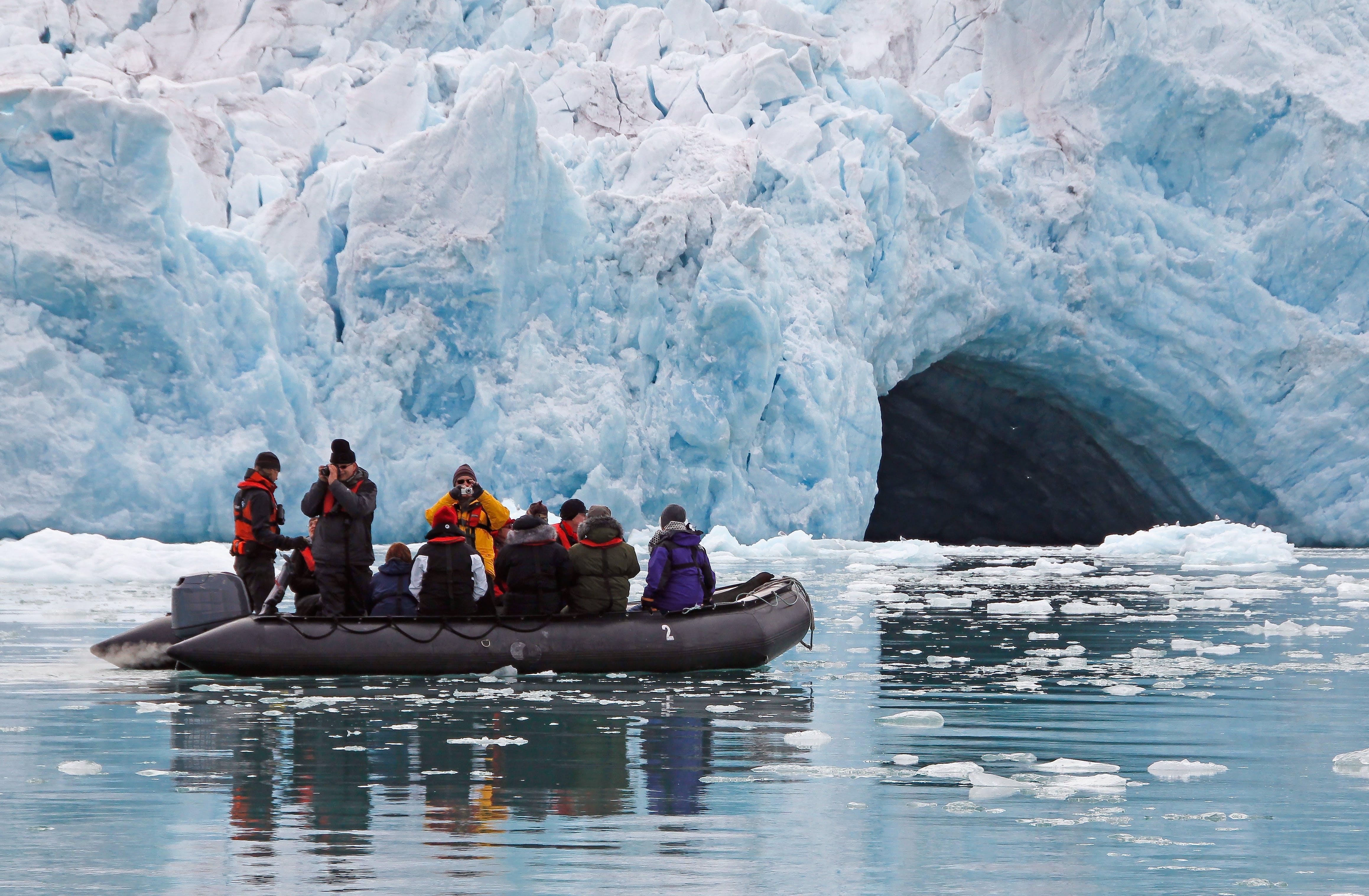 Arctic Zodiac boat near iceberg