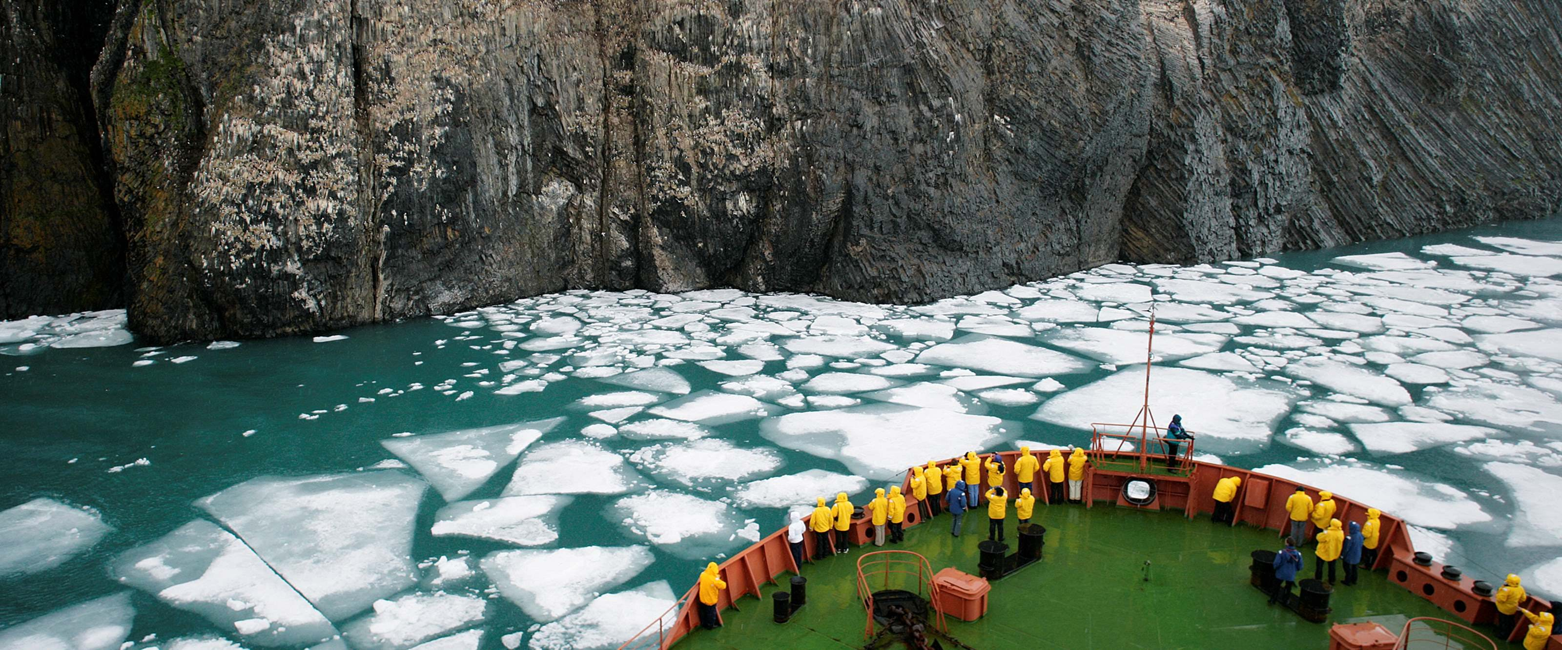 Quark ship in front of glacier