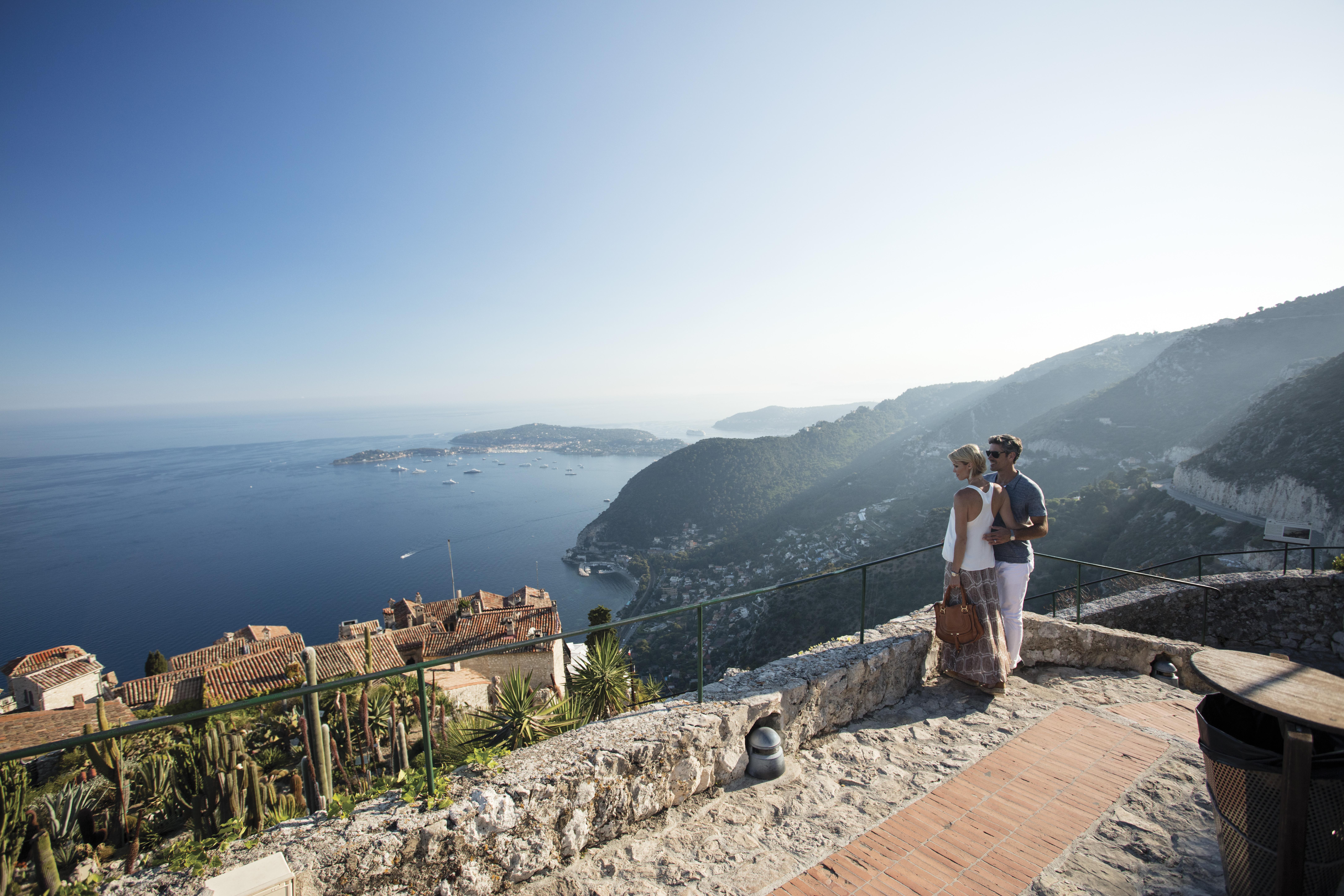 Couple in France overlooking ocean.