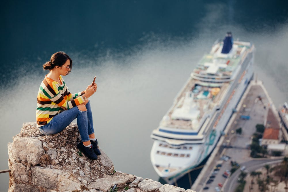Girl in front of cruise ship